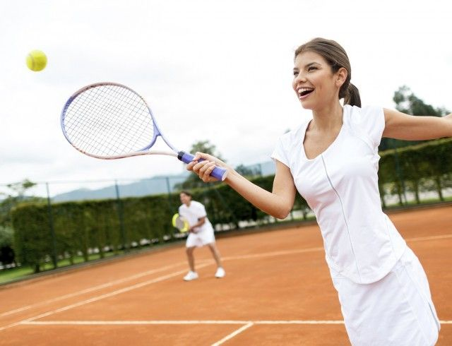 http://Woman%20playing%20tennis